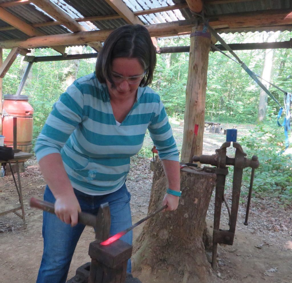 Cara Jane forging a steel blade